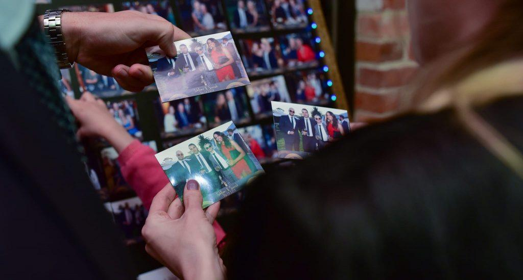 People holding photo magnets